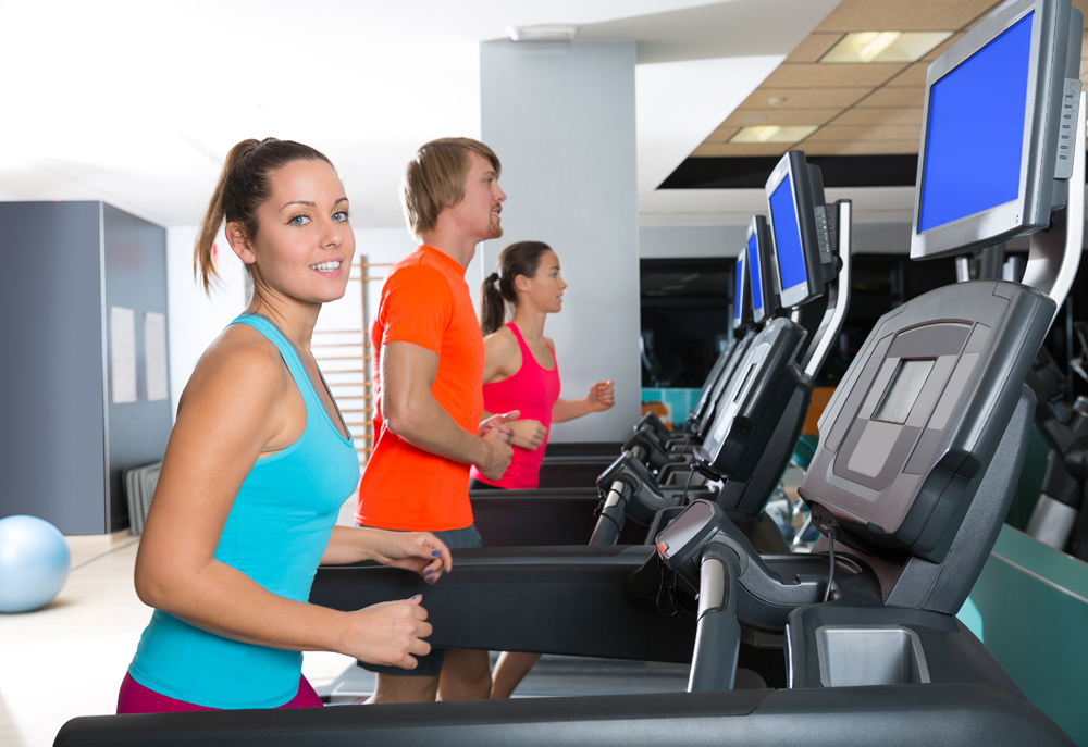 Gym treadmill group running indoor