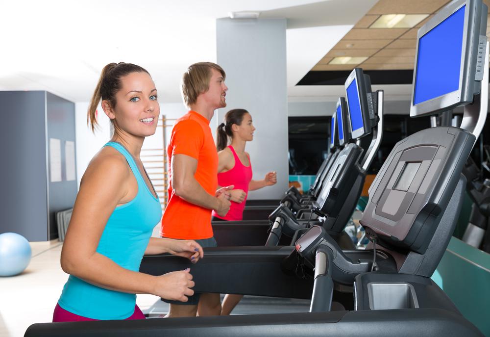 Gym treadmill group running indoor